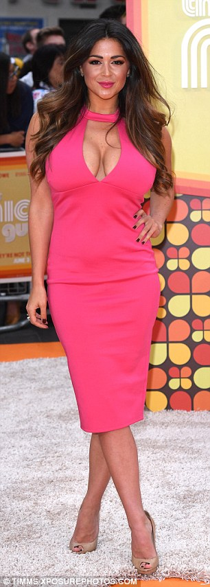Glamour: Casey Batchelor put on a very busty display in a shocking pink dress