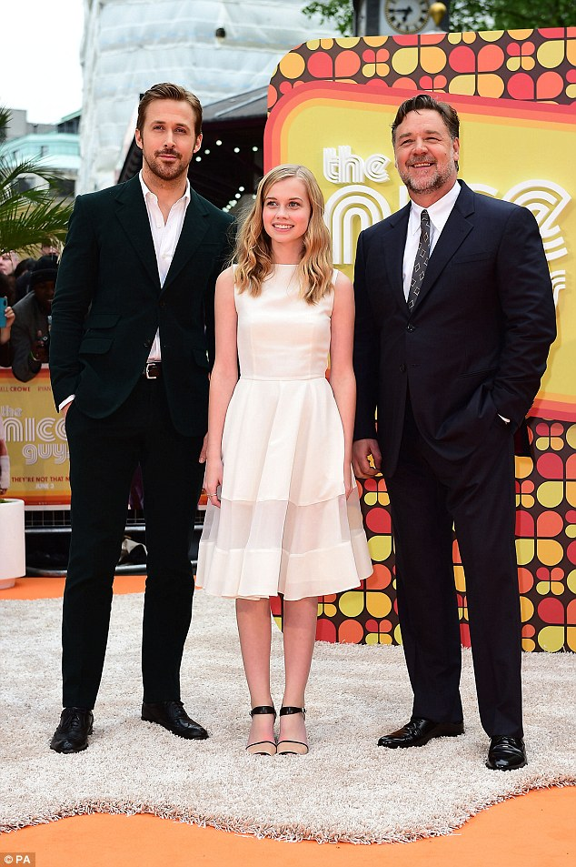 All smiles: The pair were joined on the orange carpet by their teen co-star Angourie Rice who smiled brightly in a pretty white dress