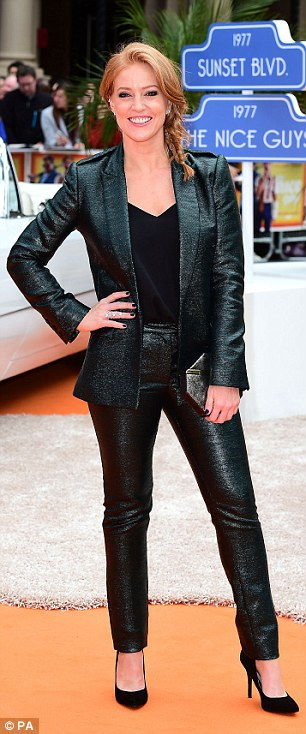 Shimmering: Sarah Jane Mee opted for a similar look with her blazer and leggings infused with a bit of sparkle