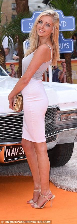 Elegant: Alice Barlow showed off her svelte frame in figure-hugging white skirt and grey vest top