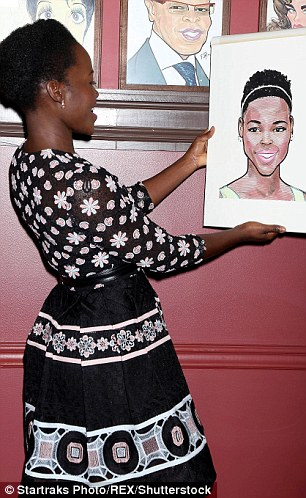 Stop and stare: The actress was momentarily transfixed as she feasted her eyes on the one-of-a-kind drawing