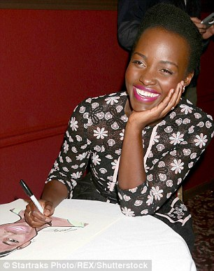 Sign, sealed, delivered:Before heading out, Lupita made sure to scrawl her autograph upon the portrait - a signature by the subject is tradition, after all