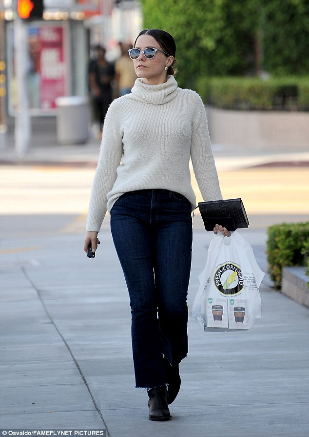 Style icon: Clad in an oversized cream polo neck, the 33-year-old actress looked effortlessly stylish as she grabbed some lunch to go, tucking her jumper into a pair of distressed hem cropped jeans