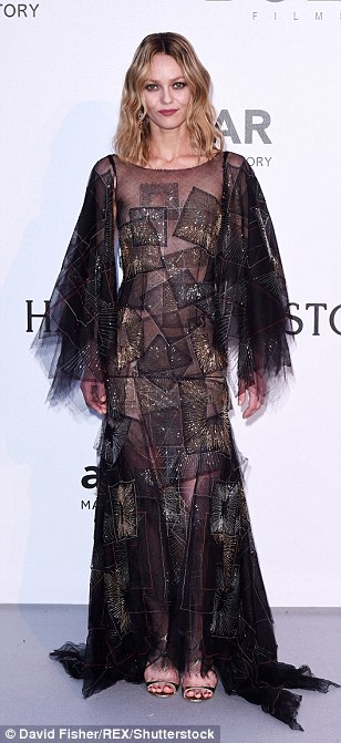 Best of both worlds: Vanessa Paradis' dress fused the look of both a vamp and a rockstar with its bat sleeves and sparkling silver and gold detailing