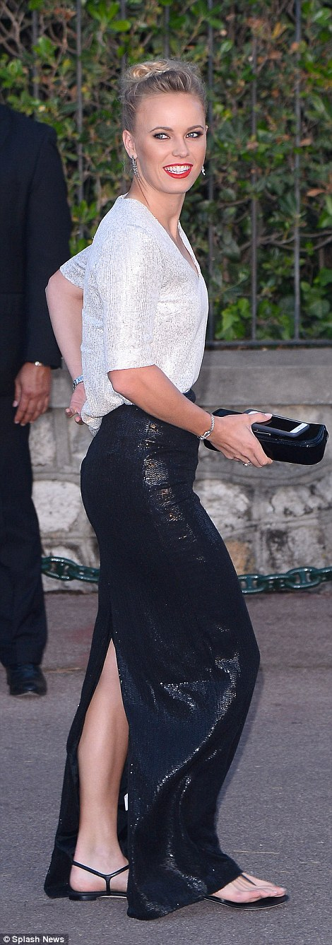 Down-to-earth: Caroline Wozniacki donned a pair of sandals instead of towering stilettos as she arrived at the gala