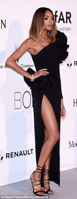 Looking good! Jourdan Dunn borrowed from the Eighties with a super retro gown boasting a dramatic one-shouldered detailing and sexy thigh split