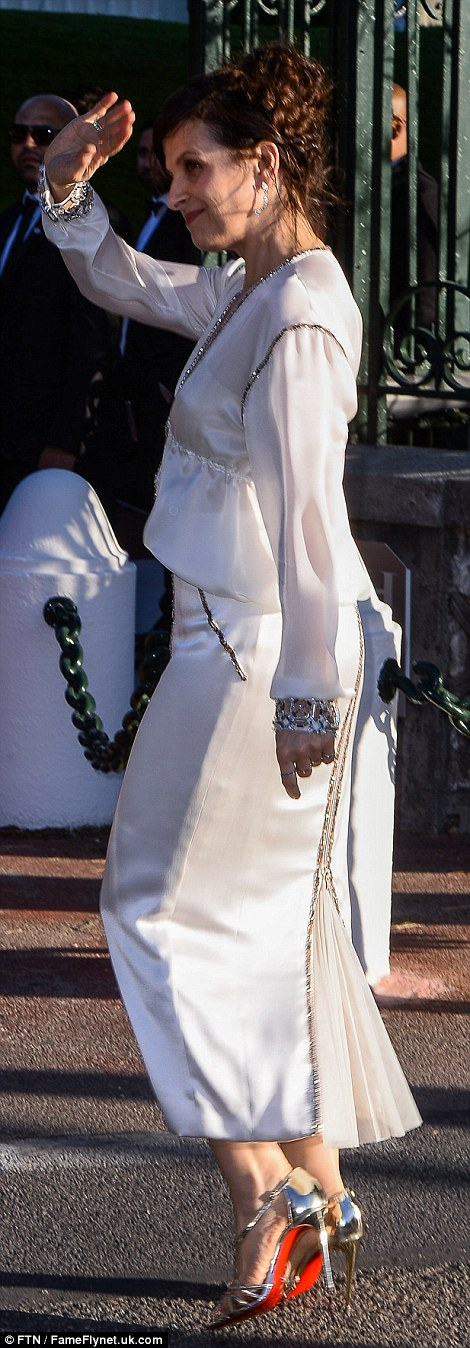 All-white on the night: Juliette Binoche looked elegant in a white silk dress with a sparkling sequinned lining