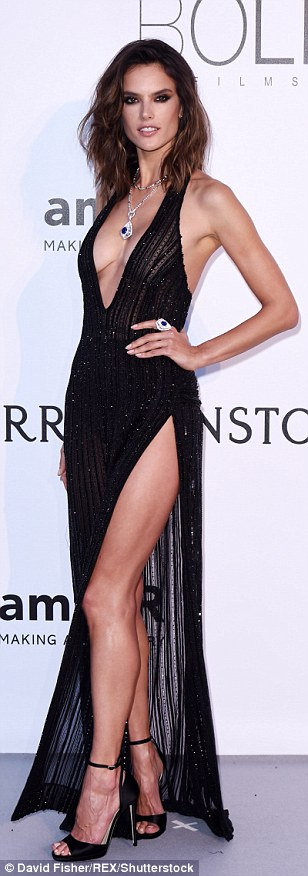 If you've got it... flaunt it! Alessandra Ambrosio broke the fashion rules and opted to show both leg and bust in a divine floor-length flock that possessed a perilously high split and a plunging neckline