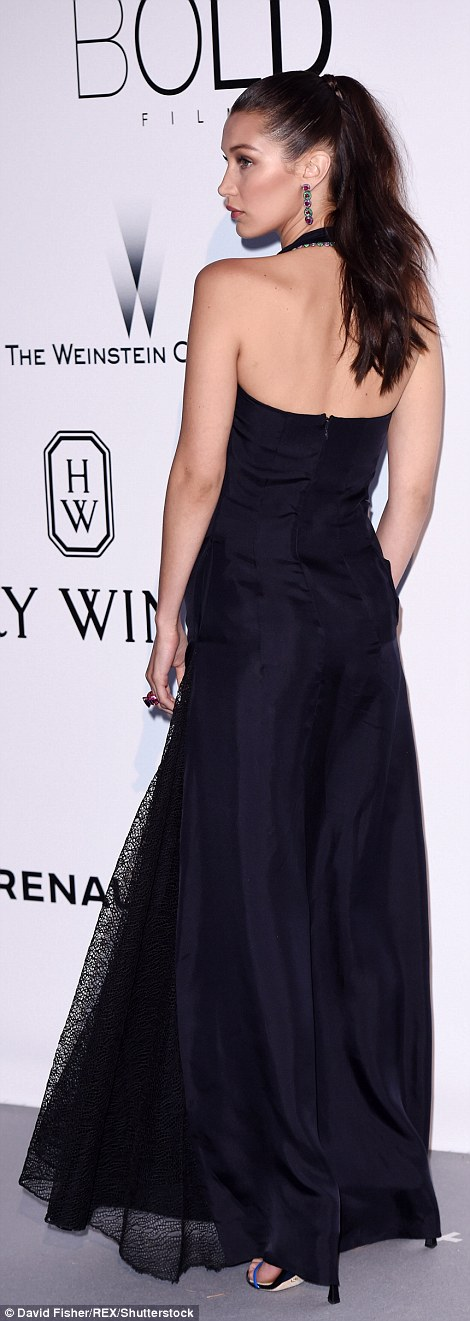 Holy cowl! The 19-year-old kept covered in a black gown that boasted a flattering cowl neckline
