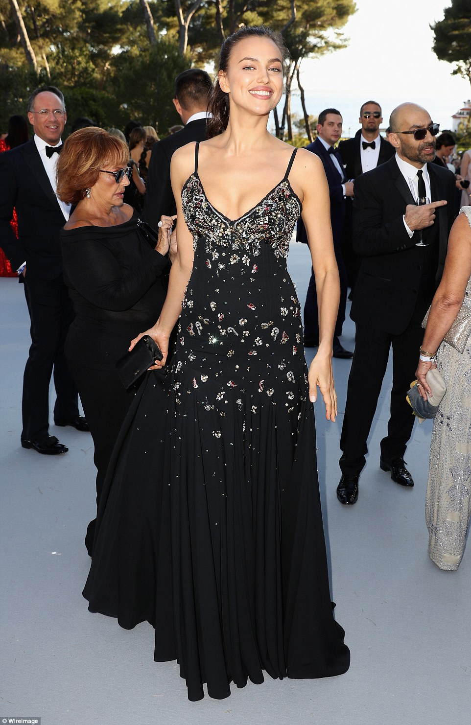 Dazzling: Irina was grinning from ear to ear as she enjoyed the festivities