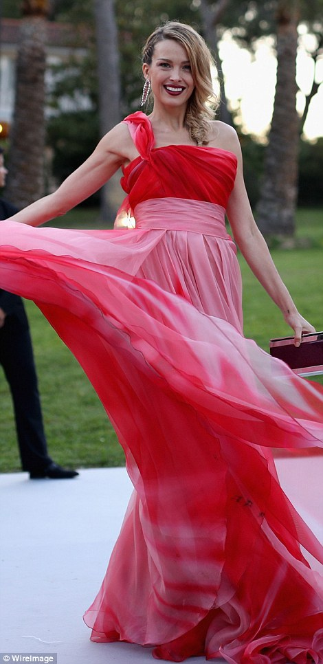 Stunning: Model turned humanitarian Petra Nemcova worked her magic in her flowing, raspberry gown