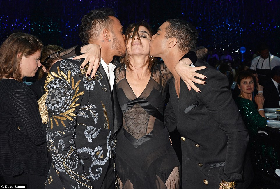Kisses all around! Both Lewis and Olivier planted a kiss on the fashion genius' look