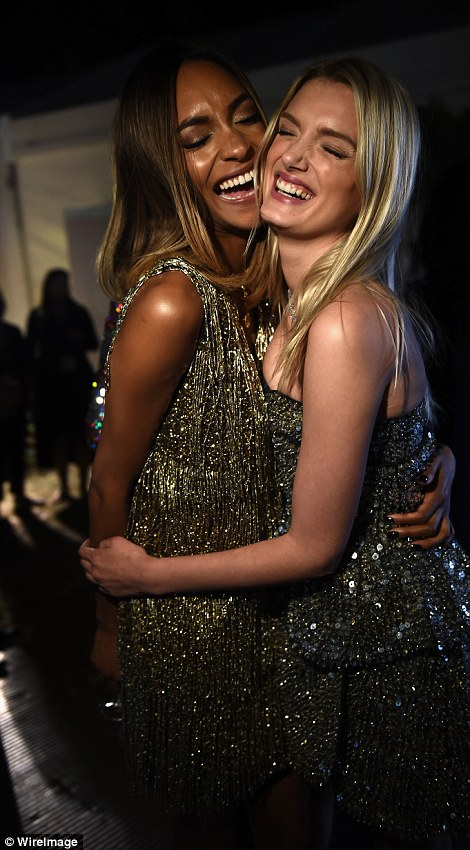 Supermodel team up: Milla Jovovitch and Eva Herzigova (L) caught up around the dinner table during the charity auction, while Jourdan Dunn and Lily Donaldson (R) shared a hug
