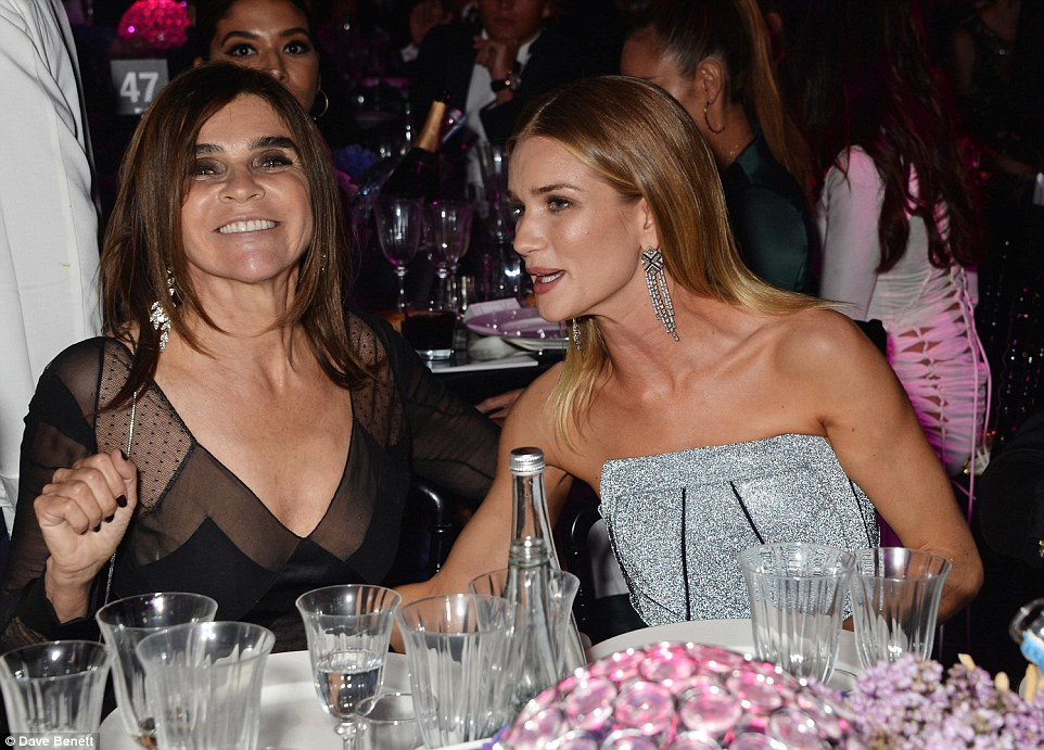 In good company: Rubbing shoulders with fashion's finest, Rosie was also sat with Vogue Paris' editor-in-chief Carine Roitfeld