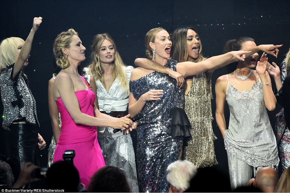 Animated display: The models were in their element onstage during the glamorous catwalk show