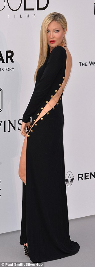 Underwear free: Model Caprice showed off some serious skin in her black dress with a slinky split running across the back