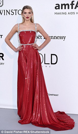 Lady in red: Lily Donaldson joined the supermodel contingent as she slipped into a dazzling scarlet gown with silver embellishments, which acted to show off her phenomenal figure