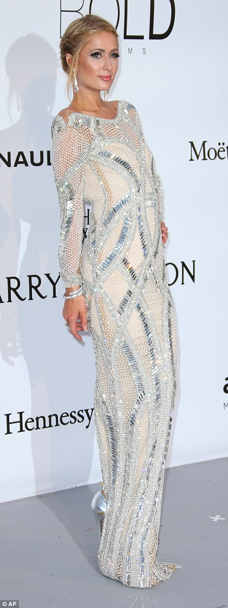 Picture perfect: Paris Hilton's glamorous frock was bedecked with mirrored embellishments that created a show-stopping glimmer when the cameras flashed