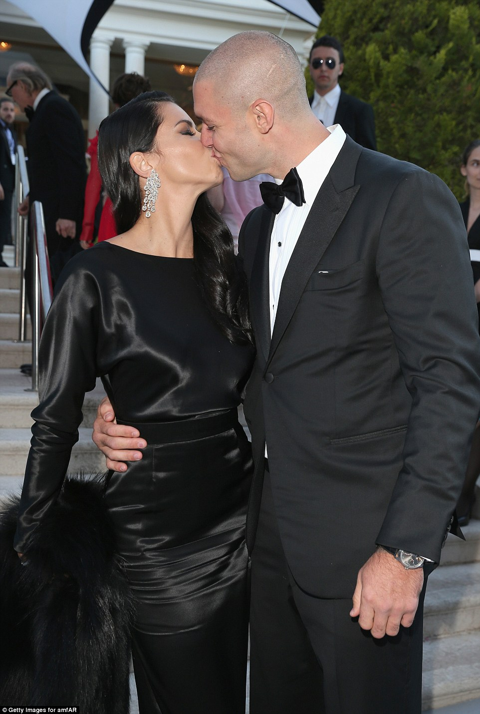 Kisses for his missus: Model Adriana Lima was given a kiss on the red carpet by her boyfriend Joe Thomas