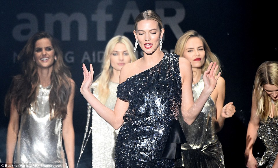 Shaking her thing:Helmed by Carine Roitfeld, the editor-in-chief of Vogue Paris, the 31 looks were dubbed the Disco Collection and were up for auction at the gala