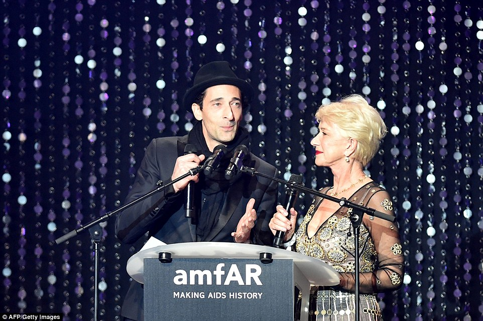 Charming the crowd:Dame Helen Mirren kicked off the auction alongside Adrien Brody as they famed pair took the stage together - much to the delight of the vying audience members - as they dazzled and chatted with ease