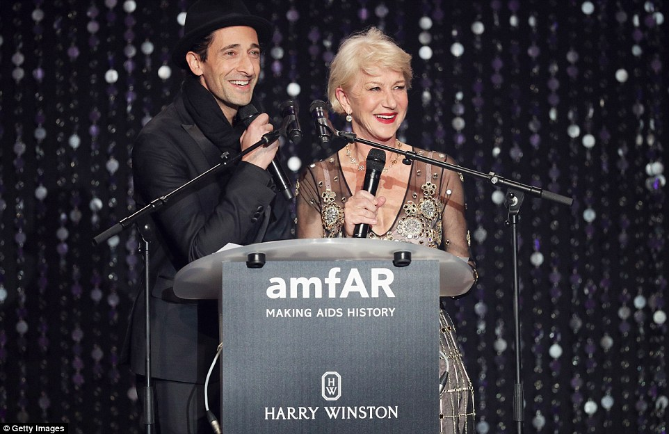 Having a laugh:The official amfAR Instagram shared an image of the two with a caption reading: 'Dame Helen Mirren on stage with @adrienbrody to kick off tonight's auction. All in support of the fight to end AIDS. #amfARCannes #Cannes2016 #hwbrilliantfutures'