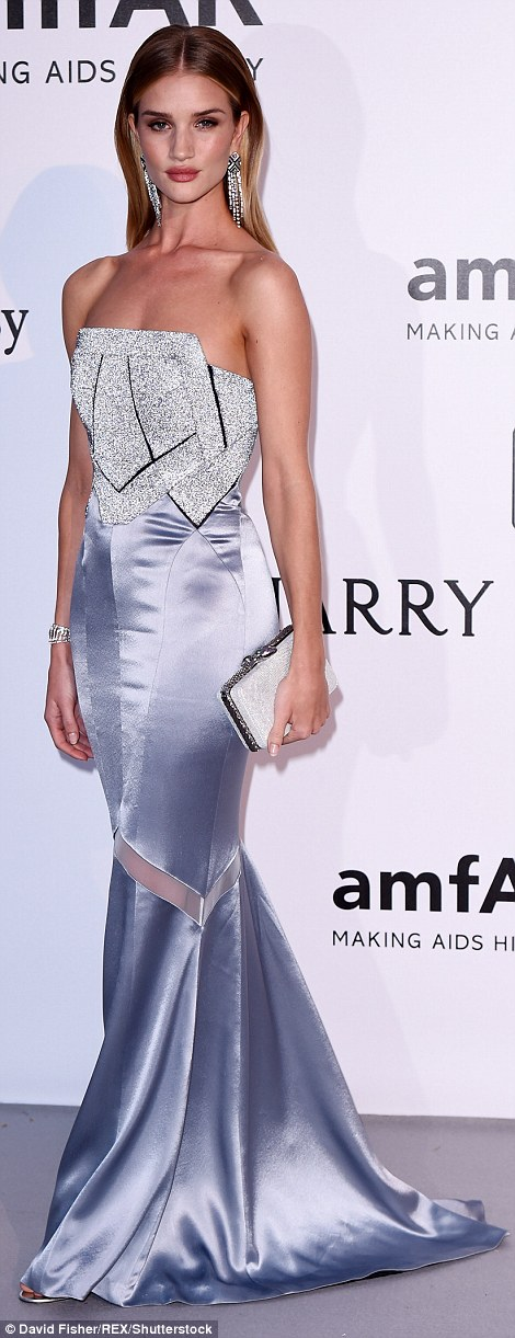 Diamonds are a girl's best friend! Rosie Huntington-Whiteley chose a stunning Galvan for Opening Ceremony satin gown with a statement Swarovski crystal corset