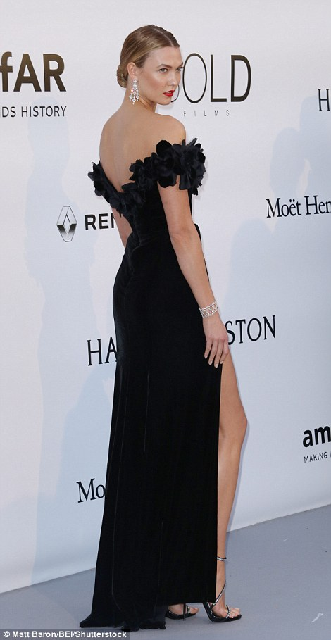 Leggy look: Karlie Kloss put on a leggy display in her stunning side-split gown with a bardot neckline