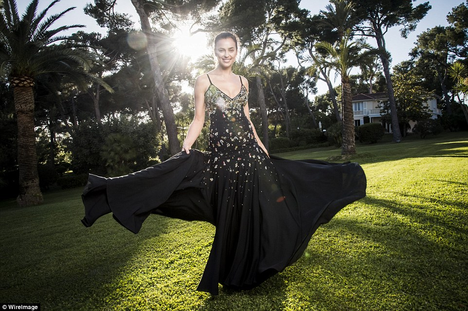 Dazzling:Russian beauty Irina Shayk added to the supermodel roster as she dazzled in a billowing embellished gown which caught the early evening light beautifully