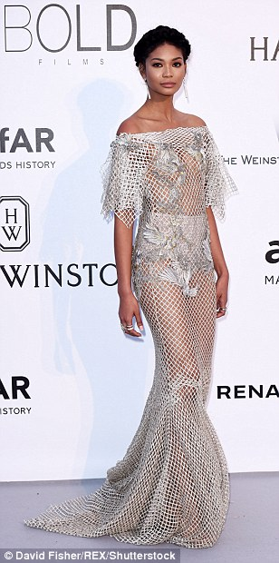 You've got chain-mail! 25-year-old model Chanel Iman wowed in a very daring Zuhair Murad Haute Couture gown as she made her big entrance at the star-studded event. Chanel turned heads in her sensational silver mesh creation