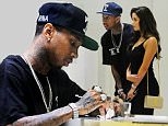 Tyga and Demi Rose are seen leaving their hotel and heading to Saint Laurent for some shopping. The couple were in there for a couple of hours and Tyga was seen picking out outfits and shoes for Demi. Whilst they were waiting to pay Tyga is seen giving Demi a chewing gum and then is seen signing for the clothes. They then left the store and arrived for dinner in Cannes.\n\nPictured: Tyga, Demi Rose\nRef: SPL1287315  200516  \nPicture by: TGB / Warner / Splash News\n\nSplash News and Pictures\nLos Angeles: 310-821-2666\nNew York: 212-619-2666\nLondon: 870-934-2666\nphotodesk@splashnews.com\n