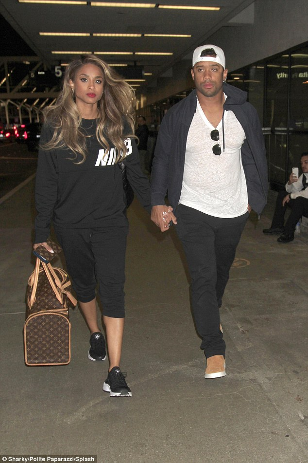 Vegas bound! Ciara dresses down as she jets off with fiance Russell Wilson on Thursday night ahead of the Billboard awards in sin city on Sunday night