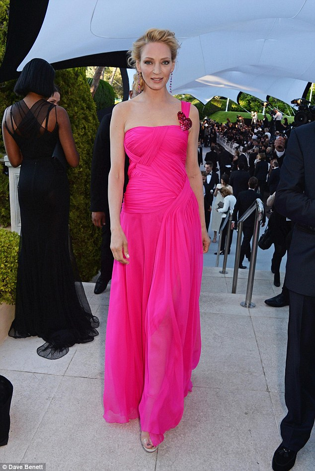 Good choice: Featuring a straight neckline, the column gown was made of a floaty material which gave her a stylish, seasonal feel