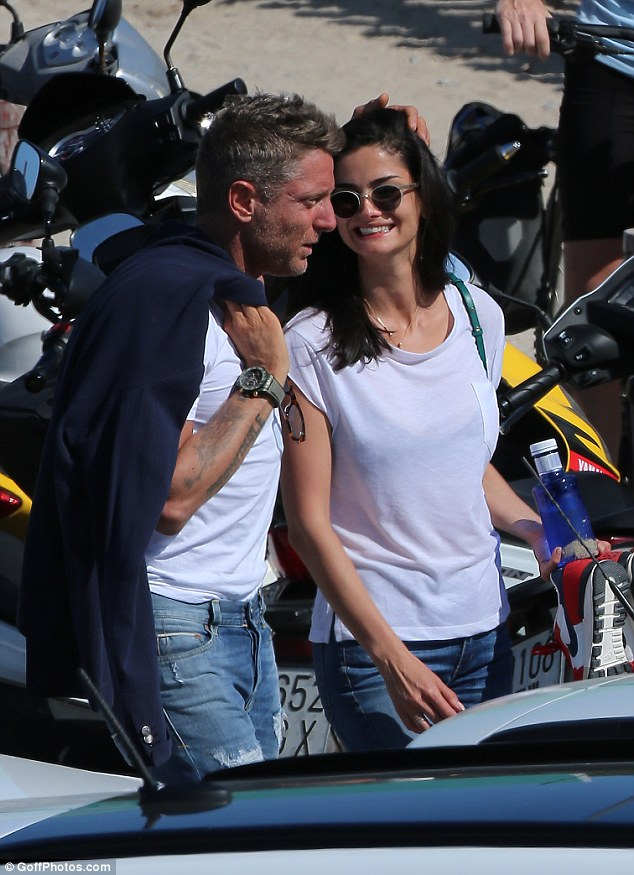 Jetting off: Fiat heir Lapo Elkann was spotted holidaying in Ibiza, Spain with a striking brunette following theamfAR Gala on Thursday night