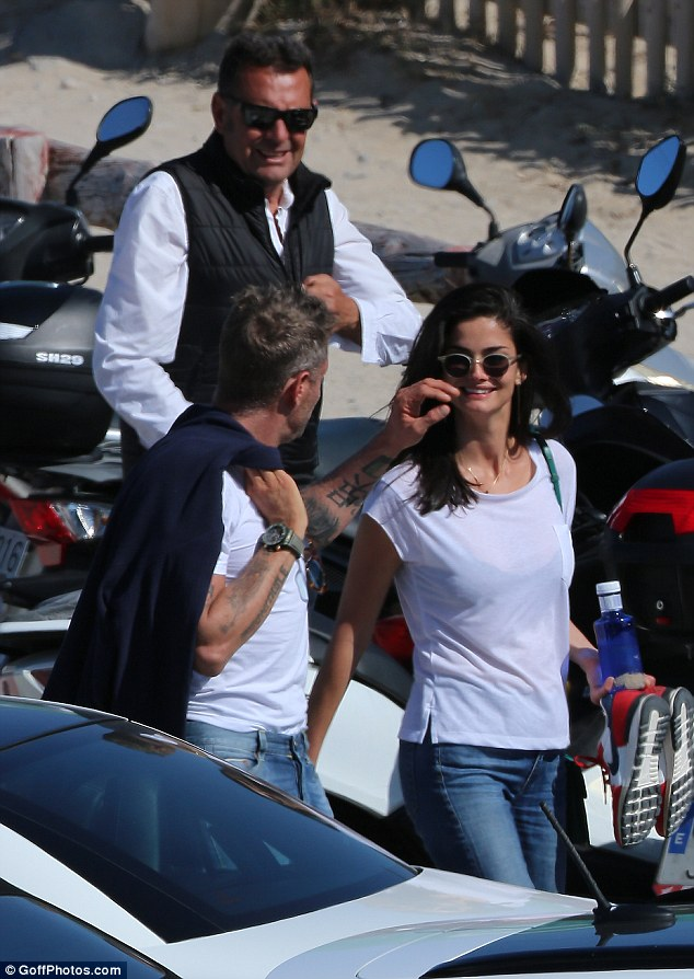 Smitten: Lapo was seen brushing a stray strand of hair from his gorgeous companion's face