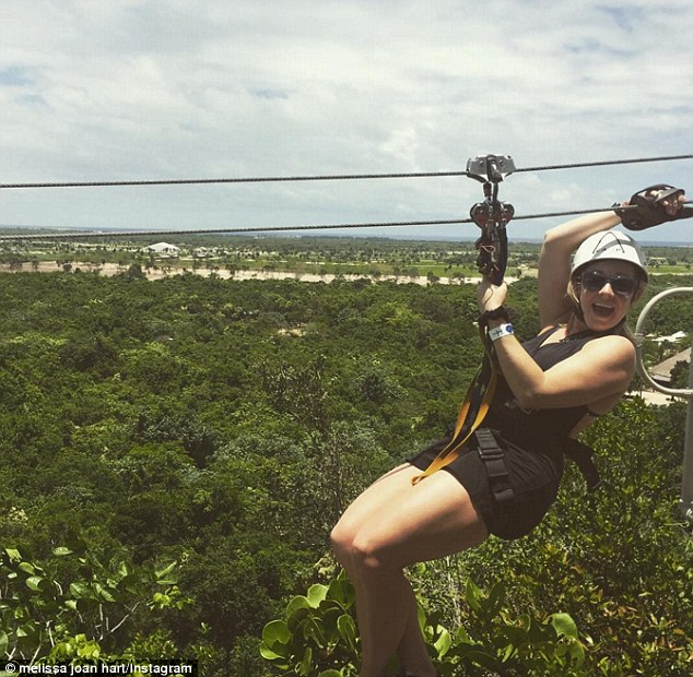 Flying high: The 40-year-old showed off her adventurous side, zip-lining over the jungle