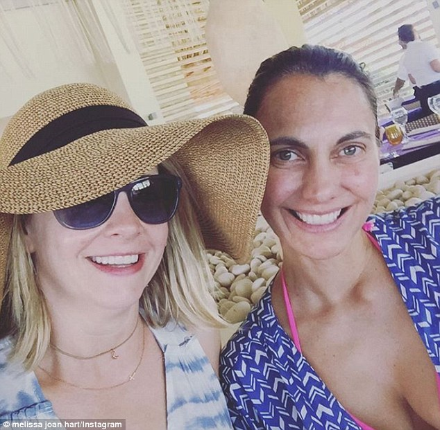 Hat's off to you! Hart posed with a pal as she announced she was 'taking over' Breathless Resort's Instagram account