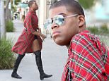 Picture Shows: EJ Johnson  May 20, 2016\n \n 'Rich Kids of Beverly Hills' star EJ Johnson was spotted paying for a parking meter in Los Angeles, California. He wore a black plaid shirt, short black shorts and long leather boots.\n \n Non Exclusive\n UK RIGHTS ONLY\n \n Pictures by : FameFlynet UK © 2016\n Tel : +44 (0)20 3551 5049\n Email : info@fameflynet.uk.com