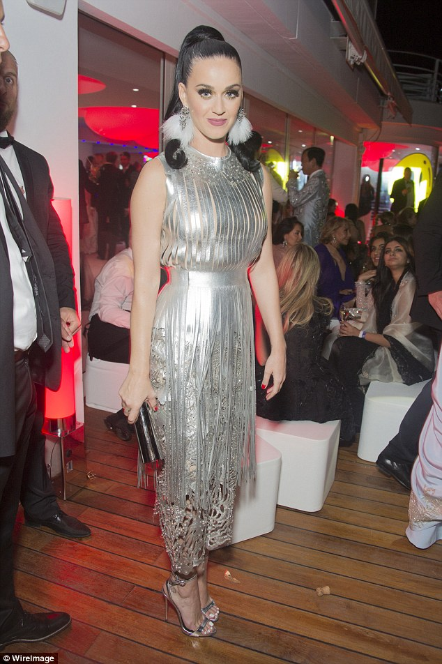 Party time: Katy Perry slipped into a silver dress, her second of the night, to join stars at the afterparty ofamfAR's 23rd Cinema Against AIDS Gala in Cannes on Thursday
