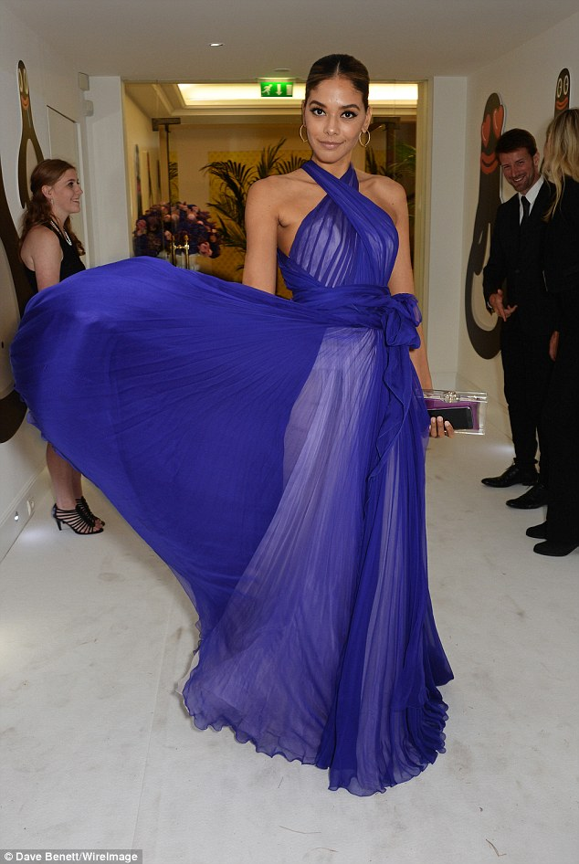 Dressed to impress: Heidy de la Rosa fanned out her gown in cobalt blue