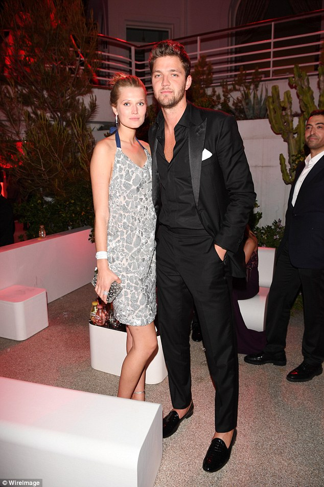 Happy couple: Toni Garrn was with her boyfriendChandler Parsons outside the party