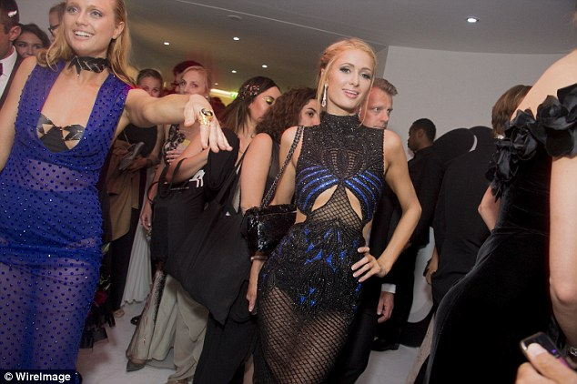Party time: Paris Hilton had changed her outfit especially to join the party