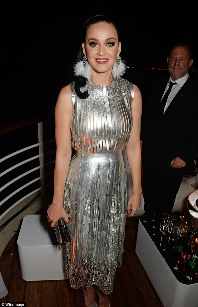 Dazzling: She was positively space age in a metallic fringed number with matching accessories