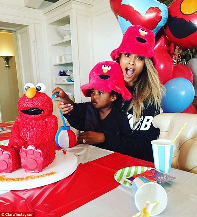 Busy day: Earlier on Thursday, Ciara posted this photo to her Instagram showing her helping her son Future Jr., whose father is the rapper Future, celebrate his second birthday with  an Elmo cake
