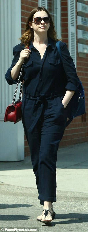 Blue belle: The Devil Wears Prada star showed off her post-baby figure in a form-fitting, navy blue jumpsuit