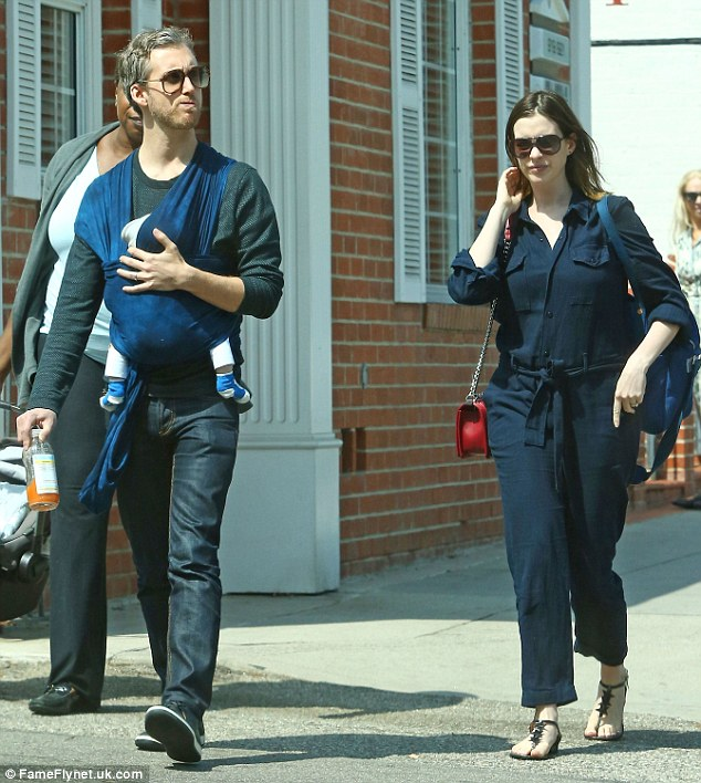 Family bonding: Anne Hathaway was spotted stepping out in Santa Monica, California on Thursday with husband Adam Shulman and their two-month-old son Jonathan