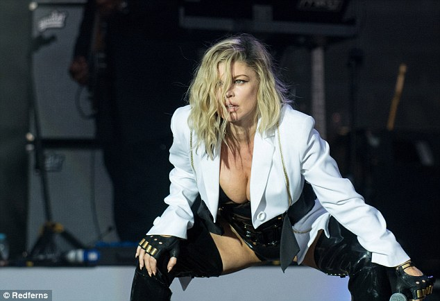 Provocative: The 41-year-old singer wore a skimpy black corset paired with patent leather thigh high boots in a racy look