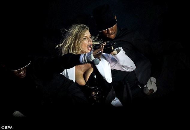 Strong performer: Fergie seemed on top form as she strutted her stuff on the stage aided by a team of backing dancers - dressed in black