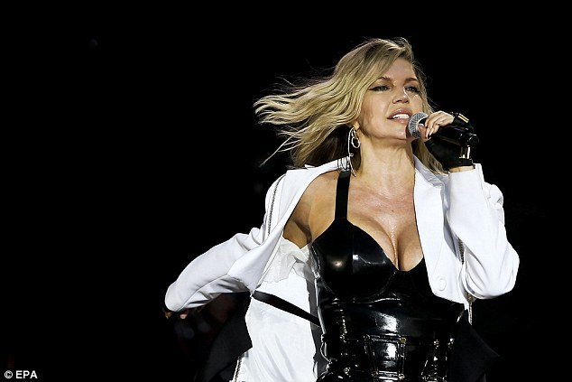 Confident: To keep out the chill Fergie completed the ensemble with a flowing jacket, left open to allow it to flutter in the breeze