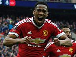 (FILES) This file photo taken on April 23, 2016 shows Manchester United's French striker Anthony Martial (C) as he celebrates after scoring their second goal during the English FA Cup semi-final football match between Everton and Manchester United at Wembley Stadium in London on April 23, 2016. He started the season derided as an expensive panic buy, but Anthony Martial goes into Saturday's FA Cup final against Crystal Palace as the potential saviour of Manchester United's season. / AFP PHOTO / ADRIAN DENNISADRIAN DENNIS/AFP/Getty Images